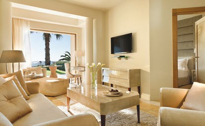 Sani Asterias Greece suite lounge with sofas view to bedroom and open view to terrace
