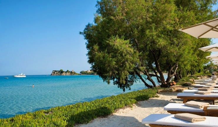 Sani Club Greece beachfront loungers umbrellas grass beach ocean