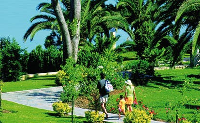 Sani Club Greece gardens family walking through paths flowers palm trees