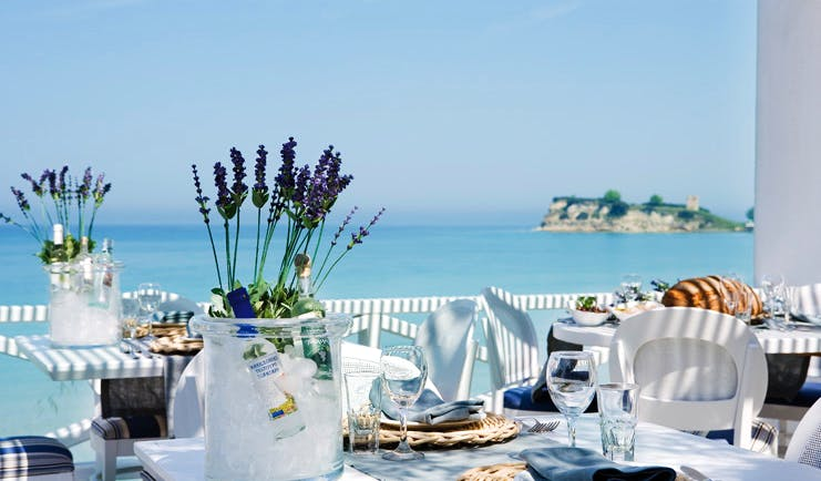 Sani Club Greece Ouzerie outdoor dining Ouzo on ice lavender sea view
