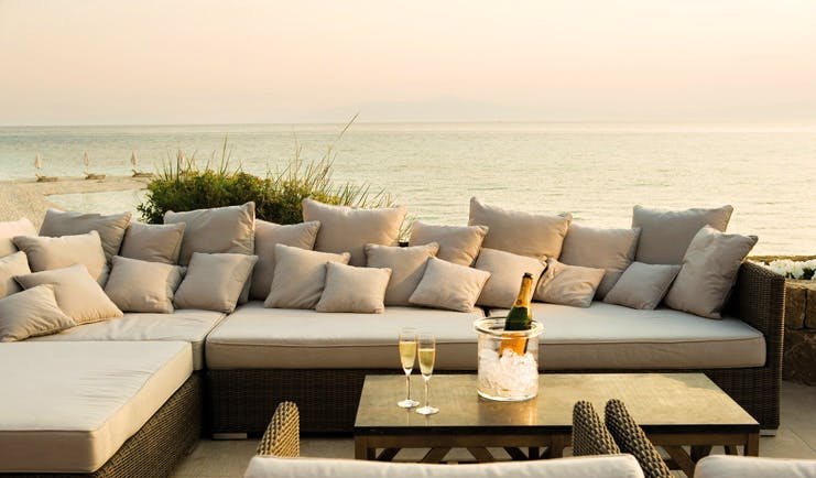 Sani Club Greece dunes outdoor lounge area sofa champagne sea view