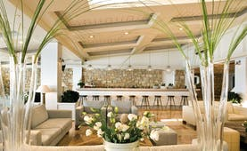 Sani Club Greece lobby minimalist decor floral arrangements bar area