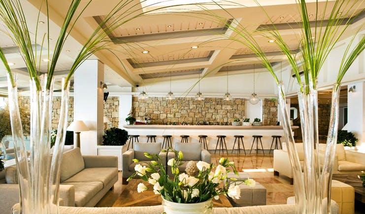 Sani Club Greece lobby minimalist decor floral arrangements bar area