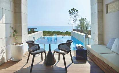 The Romanos Greece balcony private pool decked area and sea view