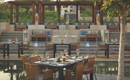 The Romanos Greece outdoor dining restaurant stepped seating area overlooking dining area