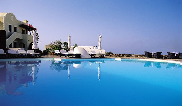 Vedema Resort Greece pool outdoor pool sun loungers seating area hotel view