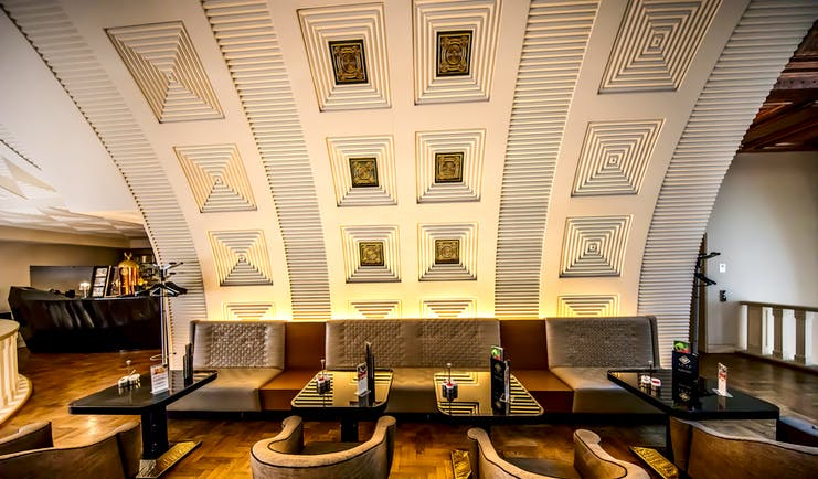 Continental Hotel gallery cafe, modern architecture with curved, carved walls and geometric patterns