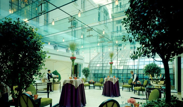 Four Seasons Gresham Palace Hungary conservatory dining area indoor trees