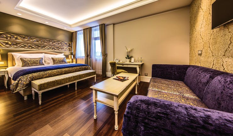 Prestige Hotel Budapest deluxe executive bedroom carved head board sofa coffee table desk and chairs