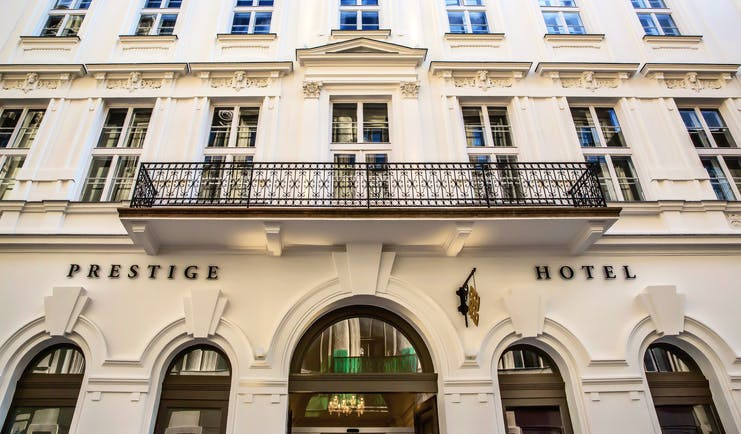 Prestige Hotel Budapest exterior facade white building with large black iron balcony