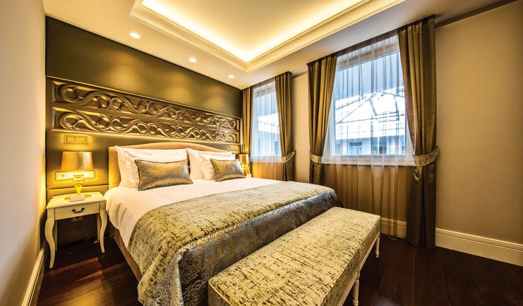 Prestige Hotel Budapest superior standard bedroom ottoman carved head board and bedside table