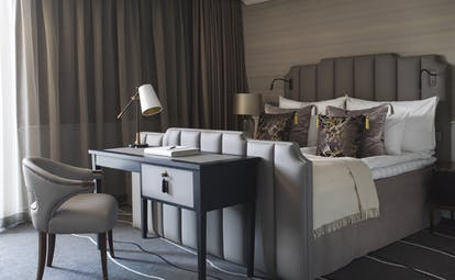 Britannia Hotel deluxe room with beige and grey and table
