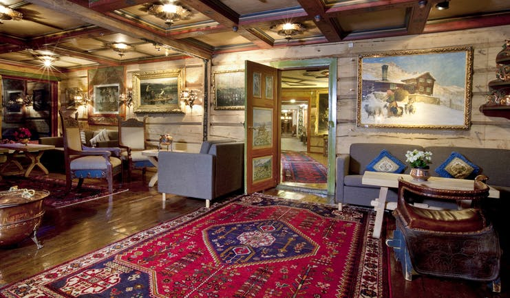 Cosily furnished lounge open fire and rugs at the Elveseter Hotel