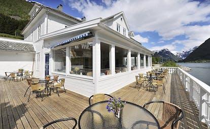 Fjaerland Fjordstove Hotell wooden decking and verandah overlooking lake