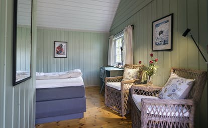 Single room with green painted wooden walls