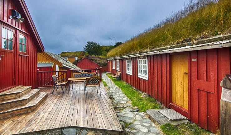 Red cabin exeteriors with grass on roof