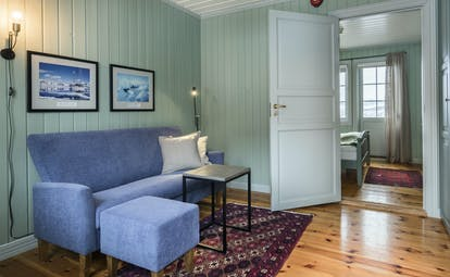 Wooden floors and blue wooden walls of suite