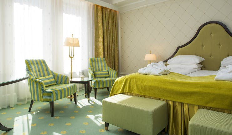 Standard room at Hotel Bristol Oslo with yellow and green soft furnishings