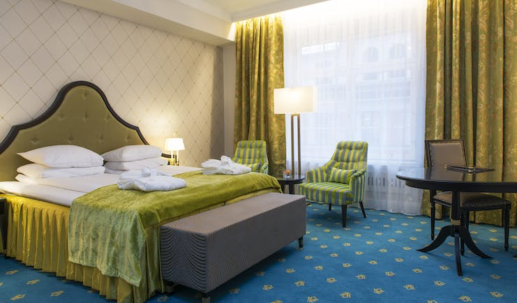 Superior room at the Hotel Bristol Oslo with yellow, green and blue furnishings