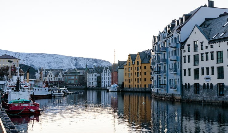 Hotel Brosundet Alesund harbour with boats and warehouses
