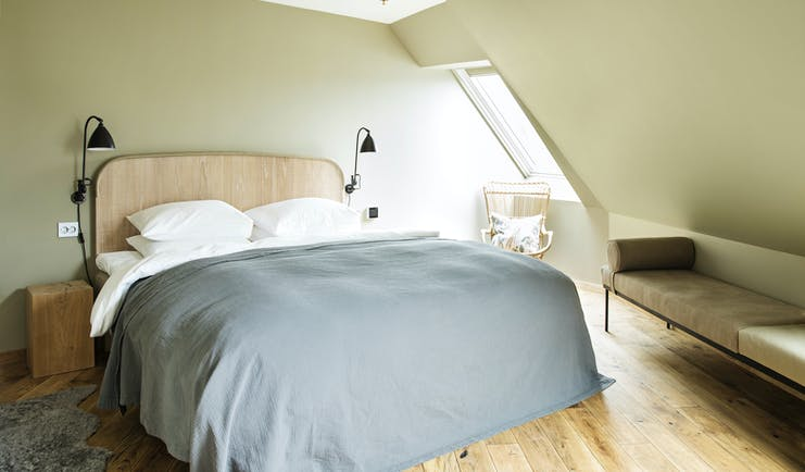 Hotel Brosundet Alesund bedroom in eaves with grey covers and wooden floor