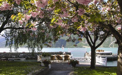 Hotel Ullensvang Norway garden by water with blossom on tree