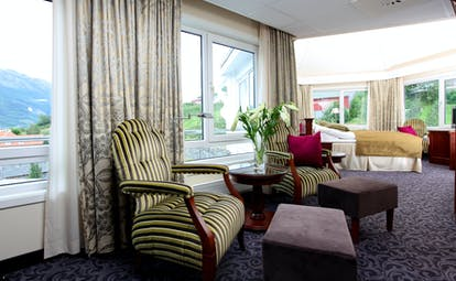 Hotel Ullensvang Norway large corner room with lots of windows and fjord views