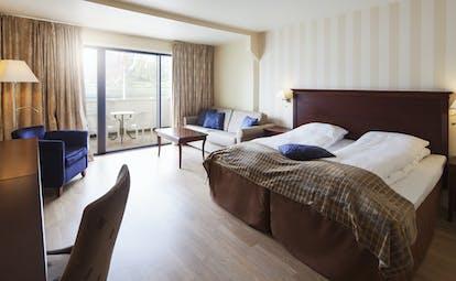 Hotel Ullensvang Norway brown and beige junior suite with balcony