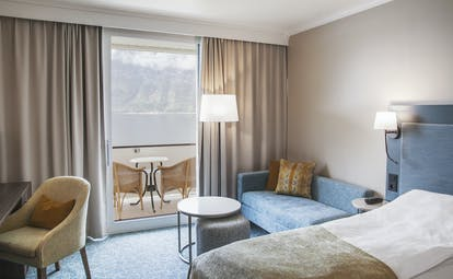Hotel Ullensvang Norway standard room with beige and blue and balcony