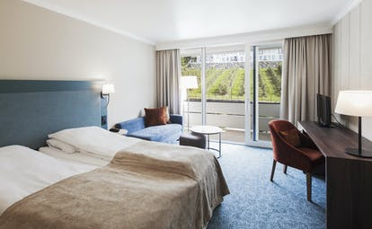Hotel Ullensvang Norway blue and beige bedroom with balcony and view