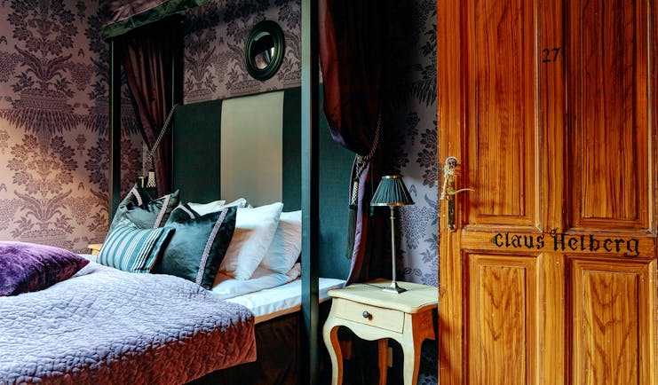 hotel union oye norway b edroom with patterned walls and wooden door