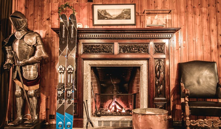 hotel union oye norway fireplace with skis and suit of armour