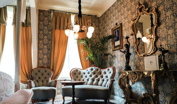 hotel union oye norway antique furnirutre and flowered wallpaper