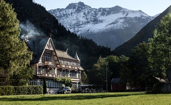 hotel union oye norway tall house with steep roof and grass and mountain