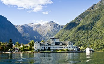 Exterior of white hotel building on fjord side at Kviknes hotel