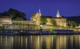 Akershus fortress castle in Oslo by water at night