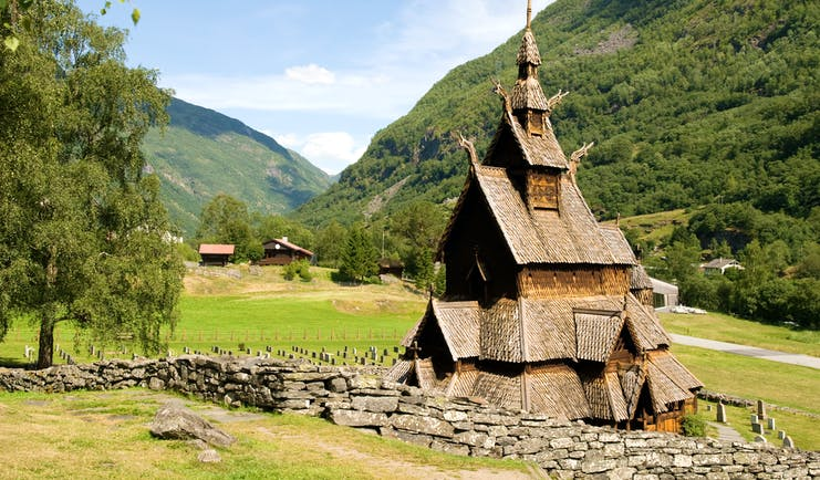 Wooden stave church in field at Borgund
