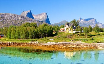 Efjorden Norway mountains, house and bright green blue water
