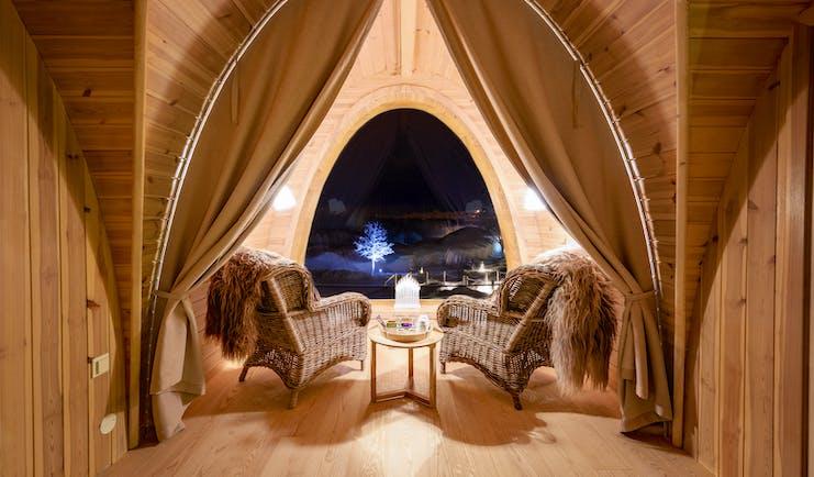 Snowhotel Kirkenes inside wooden cabin with big window