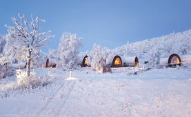 Snowhotel Kirkenes wooden cabins in the snow