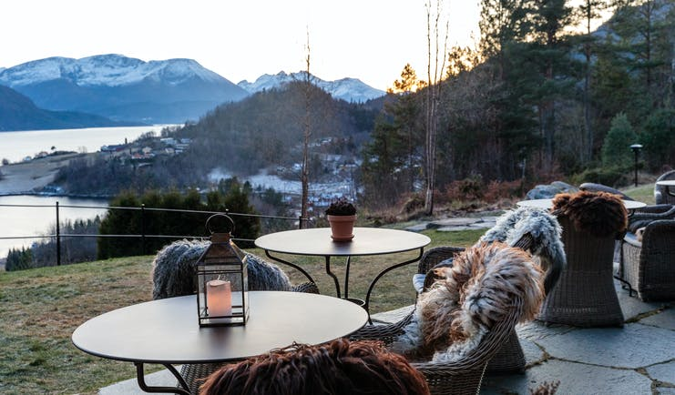 Storfjord Hotel garden with chairs and fur rugs