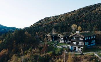 Storfjord Hotel wooden chalet buildings in trees