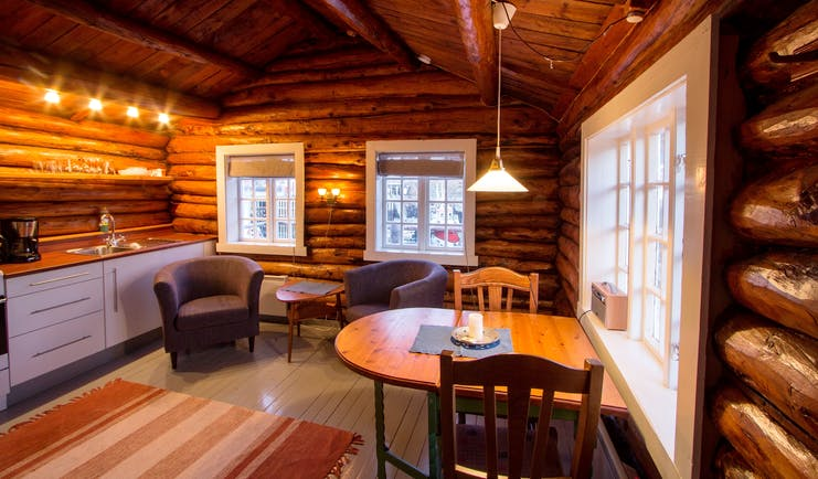 Svinoya Rorbuer kitchen and dining with wooden walls