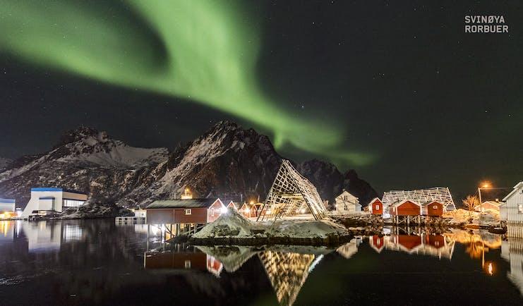 Svinoya Rorbuer green lights in sky at night