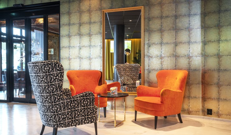 Thon Hotel Harstad lobby with orange and grey chairs