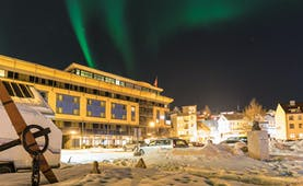 Thon Hotel Harstad snow scene outside the modern hotel building