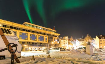 Thon Hotel Harstad snow scene outside the modern hotel building