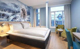 Thon Hotel Polar bedroom with polar scene on the walls
