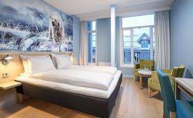 Thon Hotel Polar bedroom with polar scene on the walls