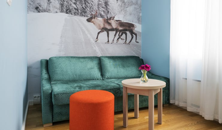Thon Hotel Polar room with reindeer and snow as wall painting